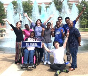 Tigerlife students in group photo in front of water fountain display