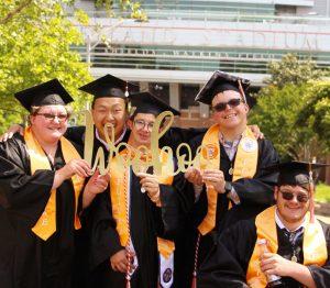 five students at graduation